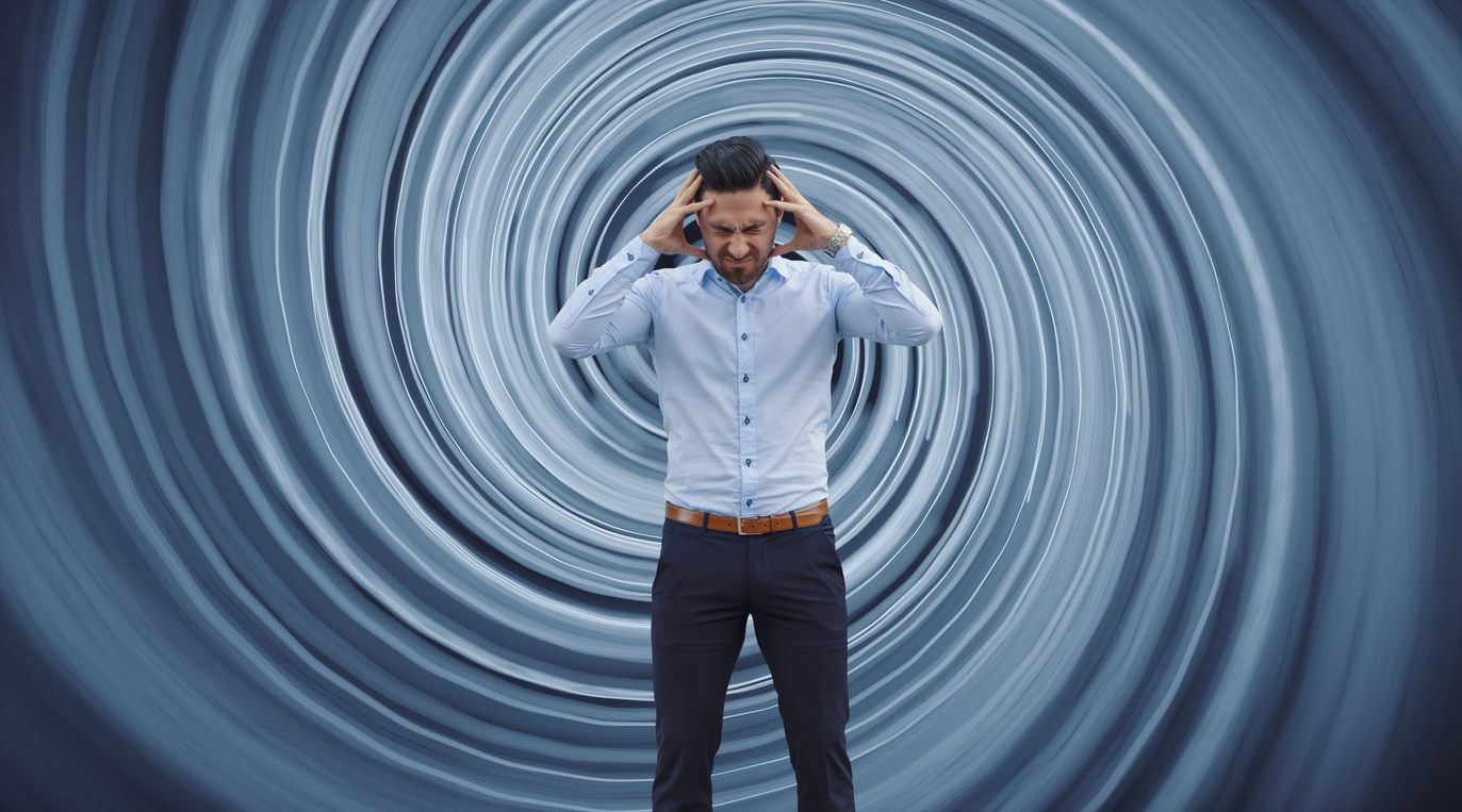 Businessman against vortex background